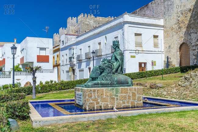 June 1, 2019: Monument to Sancho IV el Bravo in front of Castle of Tarifa
