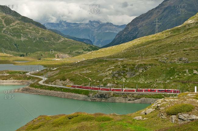 July 6, 2018: Bernina Express train beside Lago Bianco
