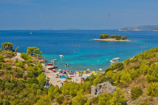 August 18, 2017: Bilo Beach near Primosten, Croatia, Dalmatia