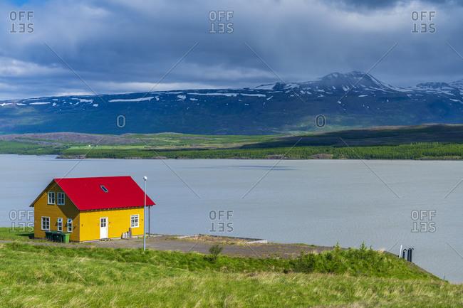 Lonely house on the shore Lagarfljot lake near Egilssta_ir