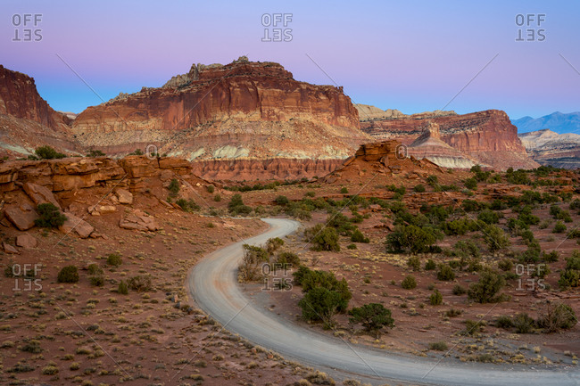 Dirt road and Whiskey Flat seen from Panorama Point at dusk