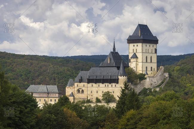 Karlstejn castle rising above the forest
