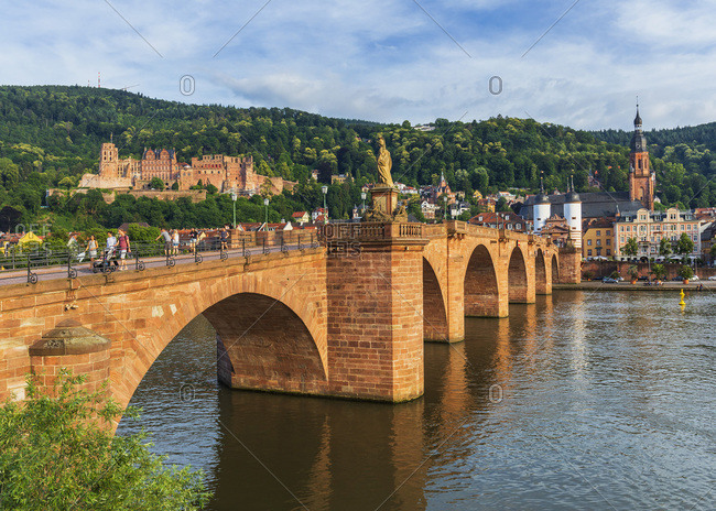 June 23, 2019: Old Town (Altstadt) along the Neckar River, with the Karl Theodor Bridge, Church of the Holy Spirit and the Castle on the hill