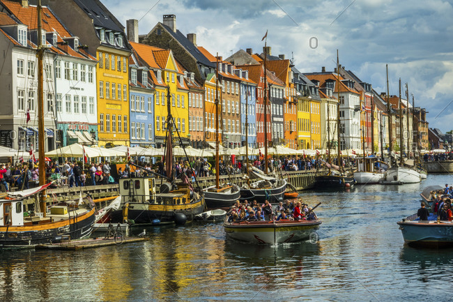 August 12, 2018: Boats and colorful houses of the Nyhavn canal in Copenhagen