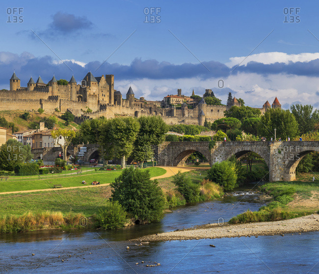 Medieval fortified city with its walls, towers and castle on the river Aude