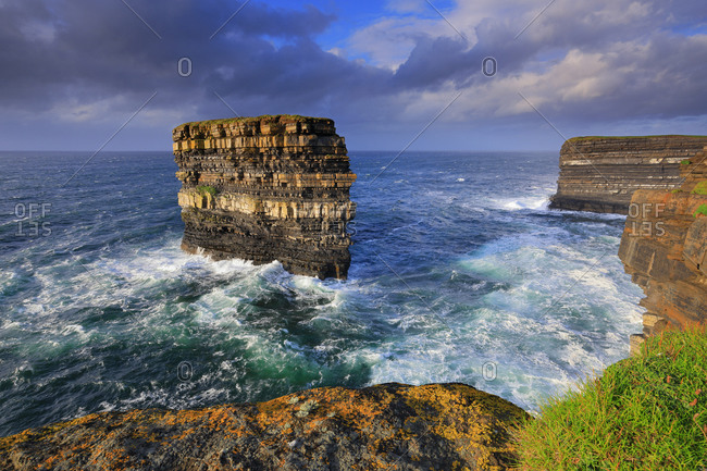 View of the imposing Downpatrick Head sea stack from the surrounding cliffs, near the seaside village of Killala