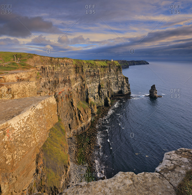 View of the imposing Cliffs of Moher in the warm late afternoon light