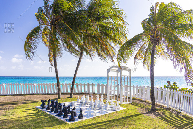 Chess in the garden of the Bouganville resort near Maxwell Beach at sunset