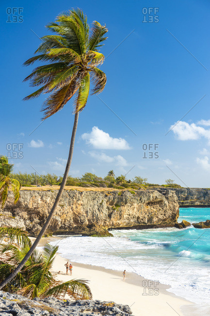 February 22, 2020: Tourists on the shore of Bottom Bay beach, Barbados