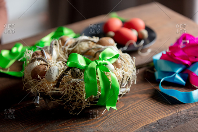 Easter wreath with eggs on wooden table