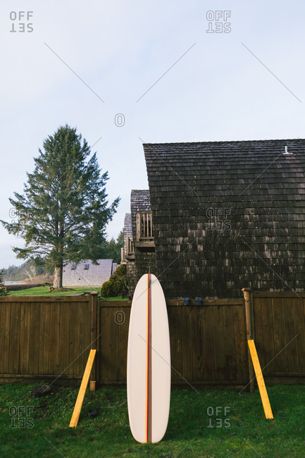 Surfboard at a cabin in the Pacific Northwest