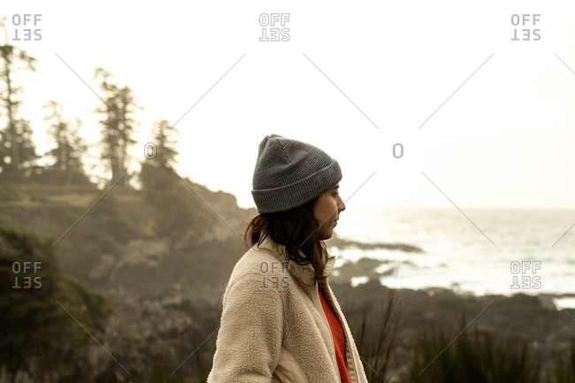 Woman looking at ocean landscape in British Columbia