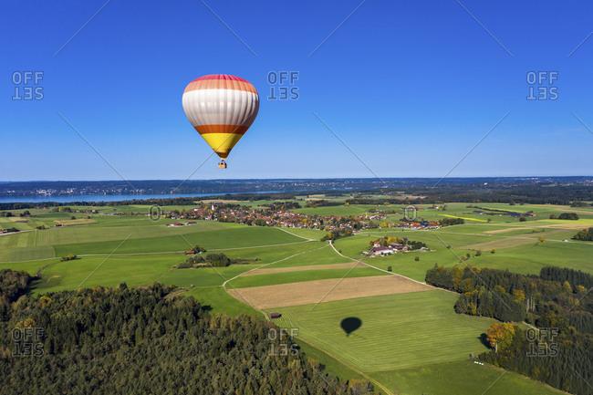 Germany- Bavaria- Hot air balloon flying over idyllic countryside