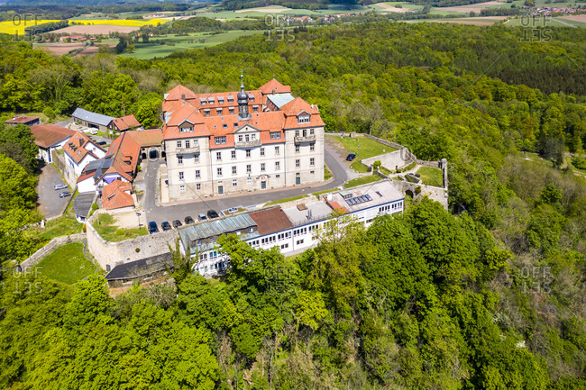 Germany- Hesse- Hofbieber- Helicopter view of Bieberstein Palace on sunny autumn day
