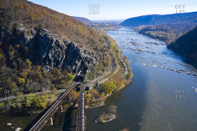 USA- West Virginia- Harpers Ferry- Aerial view of elevated railroad tracks meeting at tunnel overChesapeake and Ohio Canal