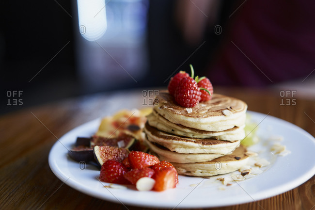 Close-up of pancake with strawberries arranged in plate at cafe
