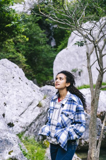 Thoughtful woman hiking in Picos De Europa mountain- Asturias- Spain