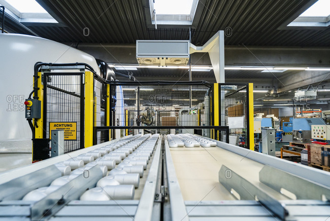Conveyor belt arranged on production line in manufacturing factory
