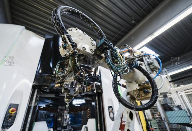 Robotic arm in illuminated manufacturing industry
