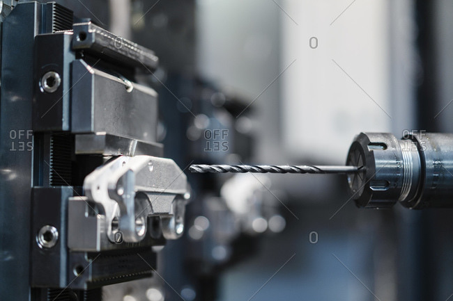 Drill press at industrial factory