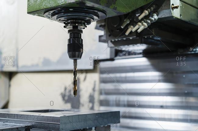 Drill machine in manufacturing factory