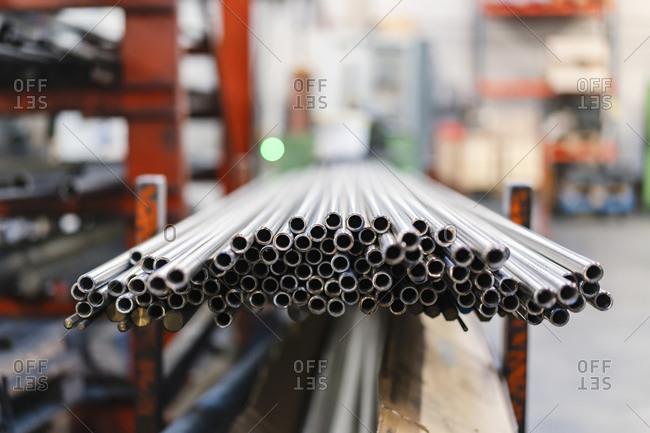 Steel pipes on shelf in factory
