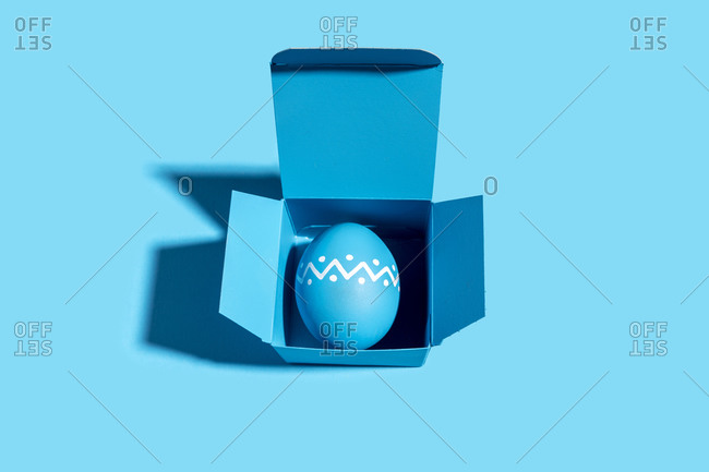 Studio shot of blue Easter egg inside blue box