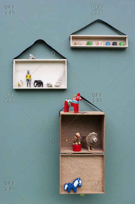Toys onDIYshelves hanging on leather strips