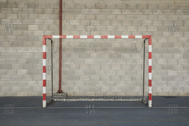 Soccer goal with wall in background