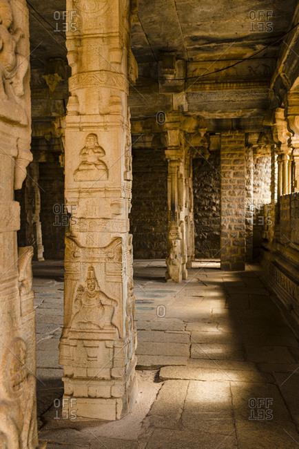 India- Karnataka- Hampi- Carved columns at temple of Vijaya Vittala complex in desert valley of Hampi
