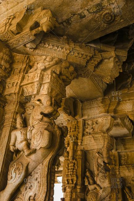 India- Karnataka- Hampi- Carvings at temple of Vijaya Vittala complex in desert valley of Hampi