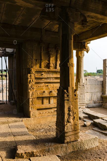 India- Karnataka- Hampi- granite temple in Vijayanagara Empire complex in desert valley of Hampi