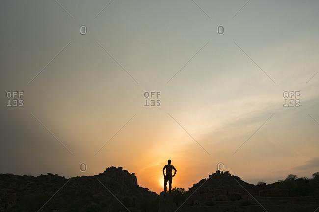 Silhouette of person admiring setting sun