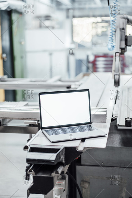 Laptop with blank screen on manufacturing equipment in industry
