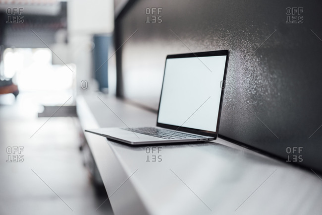 Laptop with blank screen on machinery in industry