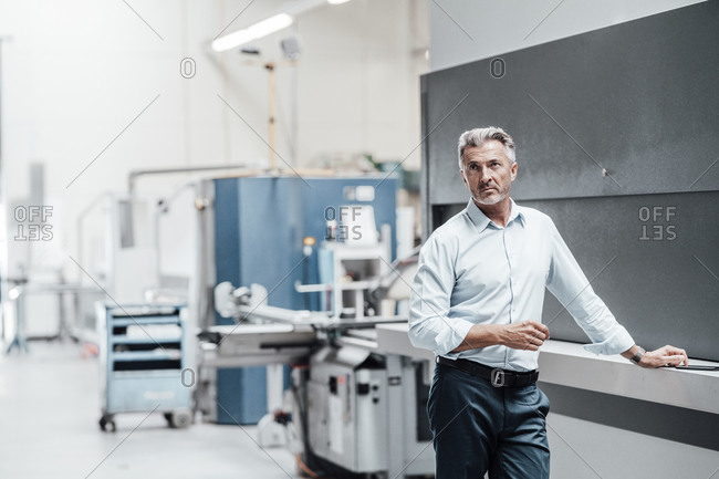 Contemplating male engineer looking away in manufacturing industry