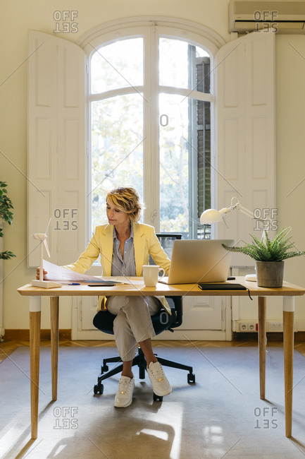 Businesswoman with concentration working in office