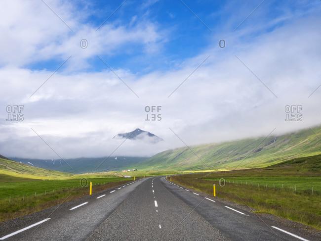 Low clouds over empty Icelandic highway