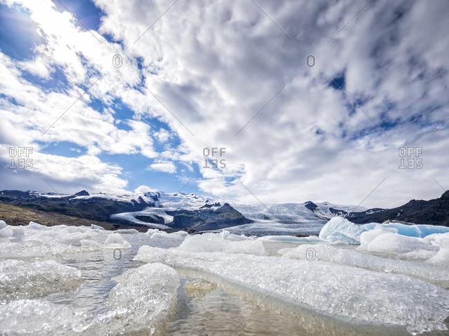Scenic view of drifting iceberg at Jokulsarlon on glacier tongue of Breidamerkurjokull- Iceland