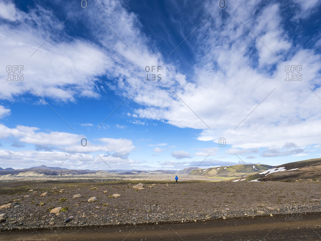 Man exploring standing on land against sky- Lakagigar- Iceland