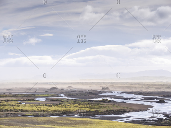 Scenic view of landscape with sandstorm against sky- Lakagigar- Iceland