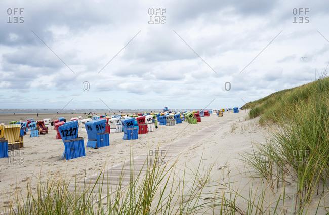 Hooded beach chairs on sandy coastal beach ofLangeoog island