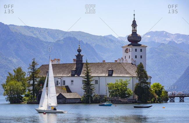 Sailing boat in lake by Schloss Ort castle- Salzkammergut- Gmunden- Traunsee- Upper Austria- Austria