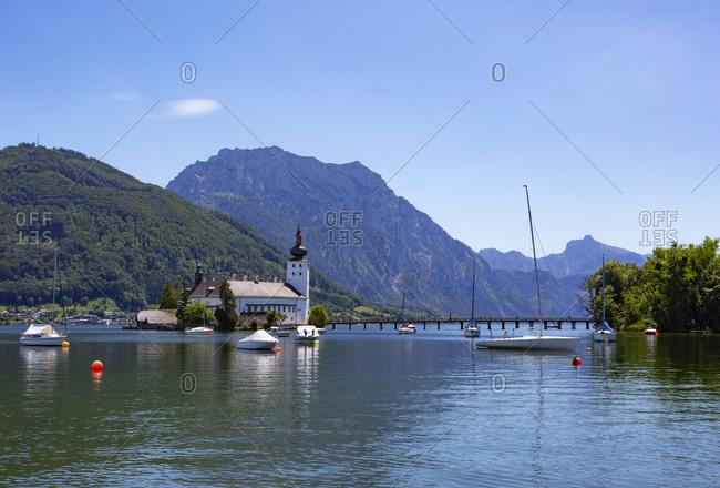 Boat sailing in Traunsee lake by Schloss Ort castle- Gmunden- Salzkammergut- Traunstein- Upper Austria- Austria