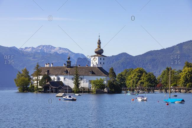 Boat sailing in Traunsee lake by Schloss Ort against sky- Gmunden- Salzkammergut- Upper Austria- Austria