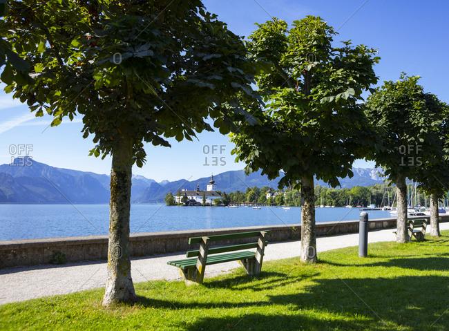 Schloss Ort seen through trees on esplanade- Gmunden- Salzkammergut- Upper Austria- Austria