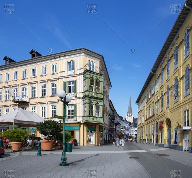 Pedestrian zone with parish church on sunny day- Salzkammergut- Bad Ischl- Upper Austria- Austria