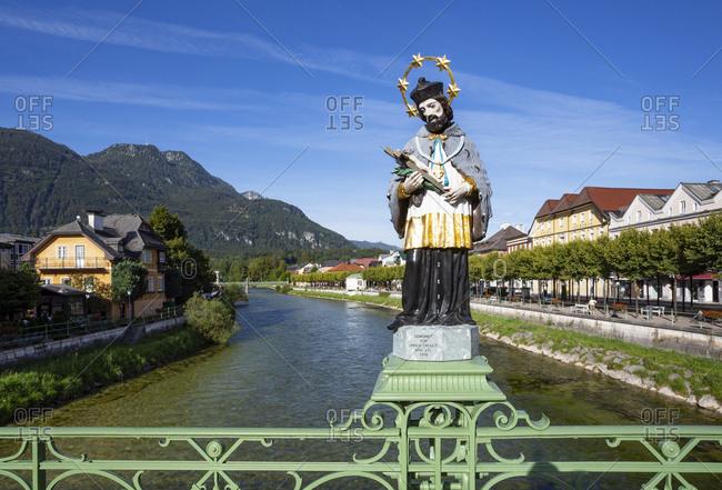 Saint John Of Nepomuk at Elisabeth Bridge over river Traun against blue sky- Salzkammergut- Bad Ischl- Upper Austria- Austria