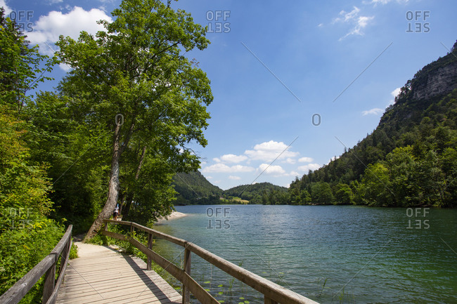 Germany- Bavaria- Bad Reichenhall- Small wooden bridge on shore of Thumsee lake in summer