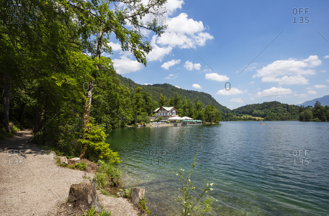 Germany- Bavaria- Bad Reichenhall- Shore of Thumsee lake in summer with restaurant in background